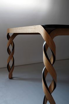 Paul Loebach's Watson table which was shown at Carwan Gallery has double-helix legs and is made of wood and carbon fiber. Paul Loebach's Watson table which was shown at Carwan Gallery has double-helix legs and is made of wood and carbon fiber. Unique Furniture, Wood Furniture, Furniture Design, Furniture Plans, Inexpensive Furniture, Furniture Websites, Furniture Online, Furniture Stores, Wood Projects