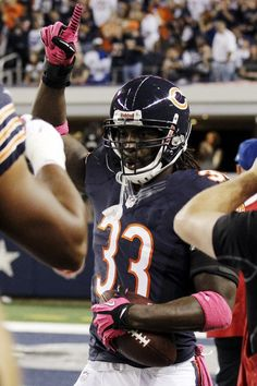 d1f5676ea Chicago Bears cornerback Charles Tillman celebrates after returning an  interception for a touchdown during the first