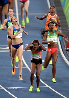 Kenya's Faith Chepngetich Kipyegon reacts after she won ahead of Ethiopia's…