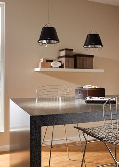 Mini Artic from Tech Lighting has a sculptural metal frame surrounded by a semi-translucent shade.  This modern contemporary fixture is simply stunning in any space.  The shade is offered in gloss black or gloss white outer color options.  Gold or silver are available for the inner color of the shade. www.luxurylightingdirect.com
