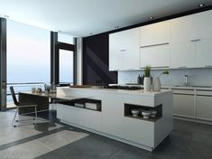 Îlot moderne et design constitué d'une table en extension dans une cuisine au mobilier blanc avec vue sur la mer