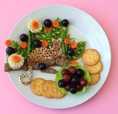 It already feels like a zoo when it comes to mealtimes---why not throw in a little amazing critter-themed food art? We bet your animals will be begging to take a bite!