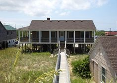 A true classic oceanfront home is what 5 Happy Clams is all about! With stunning ocean views, wide relaxing porches and even a wood burning fireplace 5 Happy Clams is the affordable oceanfront home you've been searching for.  Let the gentle breaking waves lull you to sleep while catching some rays or chill out in the screened in porch. Book this home early, it won't last too long!