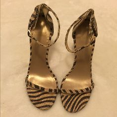 Stuart Weitzman Nudist Sandal Beautiful heels, unworn with minor scratches on the bottom surface. Material is a wicker like texture that is weaved throughout the shoe.  Tiger stripes print in nude and black pattern. Stuart Weitzman Shoes Heels
