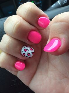 Pink and white nails with cheetah print