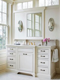 Love the shelf over the sink and under the mirror. Plus, is that a clothes hamper under the sink? What a good idea!