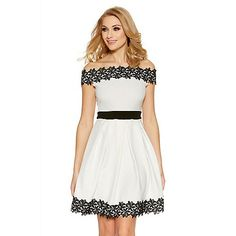 This skater dress will look gorgeous worn to a wedding event. In a bardot style, the dress features lace trim on the hems and a contrast waist band. Complete the look with barely there's and added accessories.