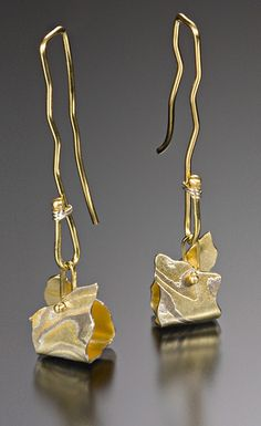 Earrings   Lisa Jane Grant. Mokume gane with 18k gold accents.