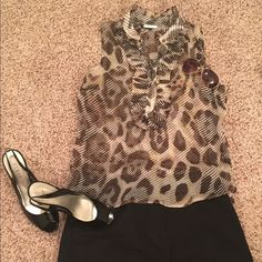 Leopards print see trough shirt This is a very light comfy see through shirt with a classy leopard print . Perfect to wear with a solid color jeans or shorts . New York & Company Tops Blouses