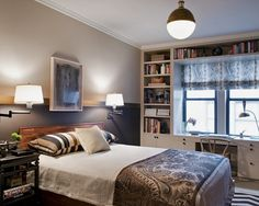 interesting height to divide the wall color - makes the bed feel cozier with the dark color below
