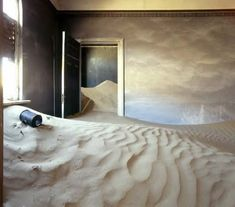 Buried in sand ~ Kolmanskop ghost town in southern Namibia. The drop in diamond sales after WWI was the beginning of the end. During the 1950's the town was deserted and the dunes began to reclaim what was always theirs.