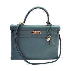 Hermes Kelly 35 cm Green Ardenne | From a collection of rare vintage handbags and purses at https://www.1stdibs.com/fashion/accessories/handbags-purses/