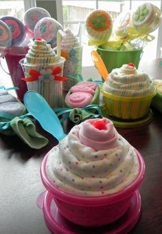 Cute cupcakes made from onesies and tupperware!