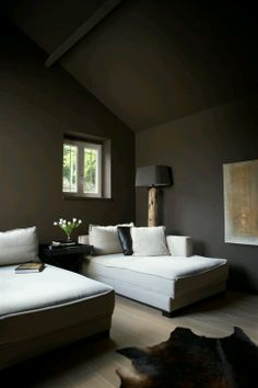 Dark walls work in a small room with light fabrics and clean lines, this is a good example.
