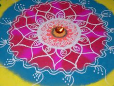 India: Rangoli can be square, rectangular or circular – or a mix of all three. They are often symmetrical. Rangoli motifs are usually taken from Nature - peacocks, swans, mango, flowers and so on.