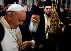 Ecumenical Patriarch Bartholomew I, second left, touches Pope Francis' crucifix at the Patriarchal C... - AP Photo/Gregorio Borgia