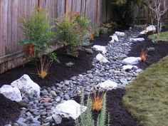 Beautiful swale with natural stone and planting