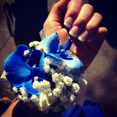 Blue corsage and French manicure for prom