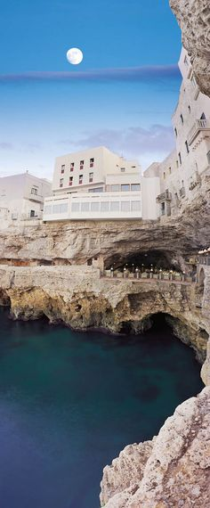 Italian restaurant in a cave. Tucked away into the wall of a cliff in Polignano a Mare in southern Italy (province of Bari, Apulia), lies a most unique dining experience at the Grotta Palazzese.