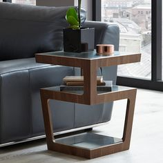 With contrasting veneer and glass shelves, this is a contemporary twist on a side table. 3 shelves provide all the storage youll need for beside your sofa or bed. Sofa Arm Table, Bed Table, Bed Side Table Ideas, Bedroom Table, Contemporary Side Tables, Modern Side Table, Furniture For Small Spaces, Home Decor Furniture, Corner Table Designs