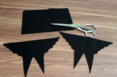 Cut bat wings and legs out of felt