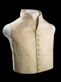 This single-breasted, waistcoat of white wool with a stand-up collar was worn by a captain or commmander. It is lined with white silk and the nine gilt brass buttons on the front feature the fouled anchor surmounted by a crown that was introduced with the 1812 regulations.