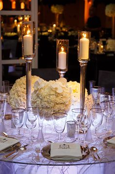 A trio of metallic candlesticks and small votive candles are a fabulous way to create a uniform, yet elegant feel.