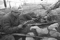 Two Red Army soldiers rest keeping their Mosin Nagant rifles handy, while a third is cleaning the bolt of his own weapon. The Mosin Nagant is still in circulation, with many WW2 specimens shooting straight and accurate even after more than 80-90 years in existence.