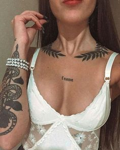 Image may contain: one or more people and closeup Rebellen Tattoo, Necklace Tattoo, Bone Tattoos, Sternum Tattoo, Chest Tattoo, Piercing Tattoo, Body Art Tattoos, Girl Tattoos, Sleeve Tattoos