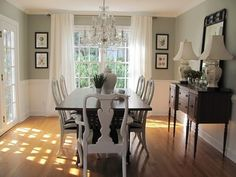 crystal chandelier with rustic table/white chairs/ buffet