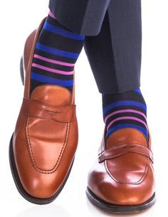 These luxury men's navy with blue and pink stripe dress socks are made with an exceptionally soft mercerized cotton. Expertly knitted at a third-generation North Carolina mill, these fashionable socks