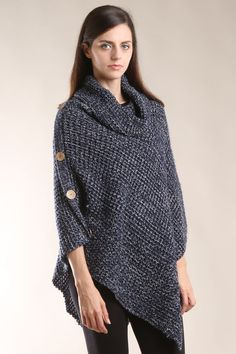 2854cb8cc5 This adorable poncho is available in black white