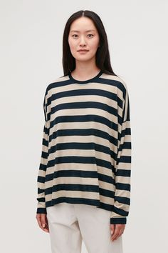 Discover our women's tops: modern styles designed to last beyond the season. Cos Tops, Cut Sweatshirts, Beige Top, Stripes Design, Trousers Women, Workout Tops, Cardigans For Women, Classic Looks, Work Wear