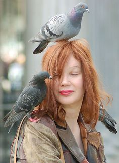 Pretty girls love pigeons! She is just stunning