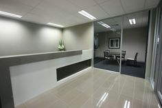 Reception counter design from A1office Fitouts to give your office's reception desk a perfect modern look.