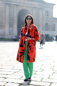 Bright fur with a bejeweled collar and green pants. #MFW