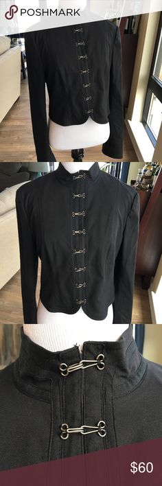 """Theory Military Style Jacket 12 Preowned Women's Theory Jacket Style Coat Military Style Jacket  Eye and Hooks for closures all the way up the front of the coat. Theory Black Jacket Size 12  Gently worn condition - no stains or holes.   Length in front 18""""  Sleeves 24""""  Shoulder to Shoulder 16.5"""" Pit to Pit Flat 18""""   Condition 8/10  Nonsmoking Home.  Thanks for stopping by my store! I make every effort to describe my items in detail, specifically any flaws or issues with my items along with…"""
