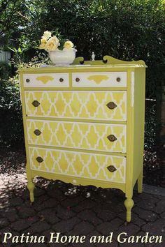 Love the stenciled drawers.... not so sure about the color though... I would go a bit more bold.