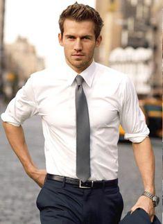 Shop this look on Lookastic:  http://lookastic.com/men/looks/white-dress-shirt-grey-tie-black-belt-navy-dress-pants/9095  — White Dress Shirt  — Grey Tie  — Black Leather Belt  — Navy Dress Pants