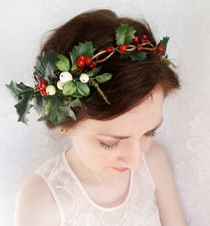 Ready to ship!!    Sprigs of holly and wintery foliage adorn this festive hair garland. Tie it up with ribons in the back, or stick the ends into