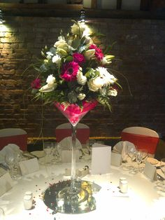 #white #ivory #cerise #hot #pink #rose #gerbera #lily #martini #vase #glass #table #centre #arrangement #cooling #castle #barn #bride #wedding #kent #London #chicweddings #chicweds