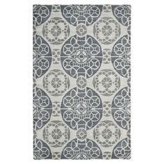 Add a pop of pattern to your living room or den with this hand-tufted wool rug, showcasing a medallion motif in silver.  Product: