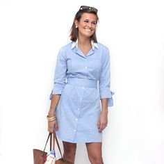 Its shirt dress shape makes this dress a summer classic, while waist-defining sash and bow cuff details give it just enough feminine edge. Pair wi...