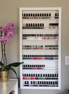 CUSTOM Wall Mounted Nail Polish Frame Rack Essential Oils Display Storage by pinkofperfect on Etsy https://www.etsy.com/listing/231627288/custom-wall-mounted-nail-polish-frame