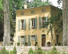 awesome Colors of Provence...Yellow Stucco with Patina Green Windows and Shutters