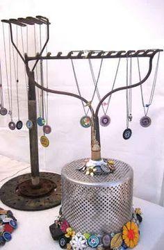 display idea  use a rake or garden tool to hang jewelry.