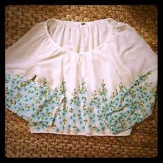 Free people stunning top The floral details are just amazing. The flowey sleeves are sheer. Mint and turquoise colors on cream base. Mint condition. I'd say it fits all sizes because of the design. It says S on the label though Free People Tops