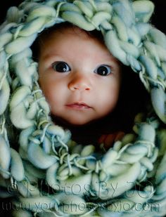 Baby's face through a blanket