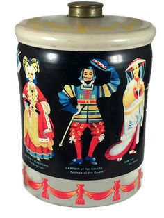 Vintage tin box with opera characters