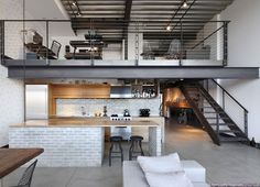 Can an industrial space be converted into a modern man's dream living space? Absolutely. Living proof is this killer loft located in the Capitol Hill area
